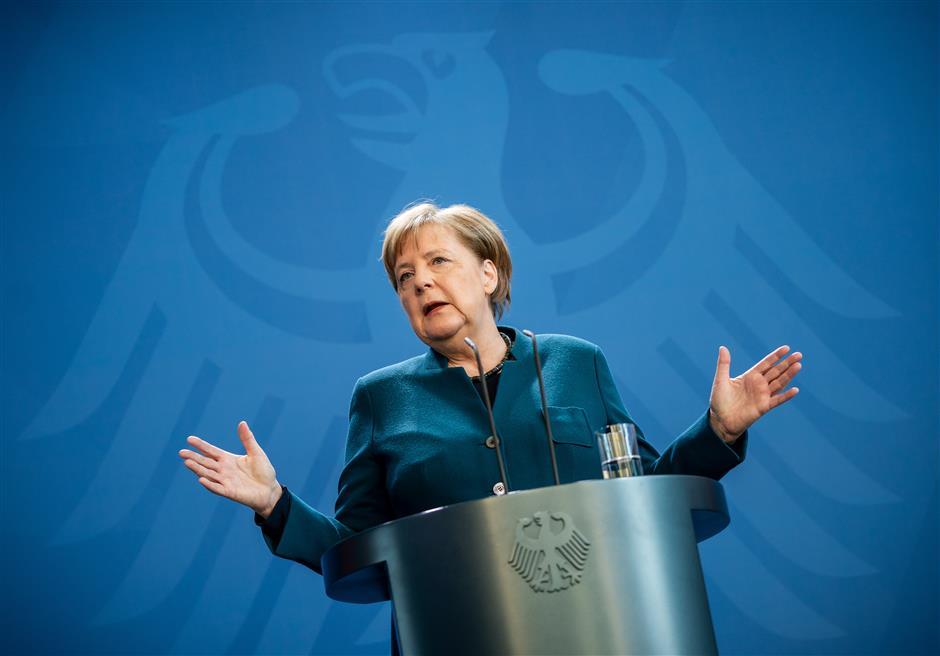 First virus test negative for quarantined Merkel