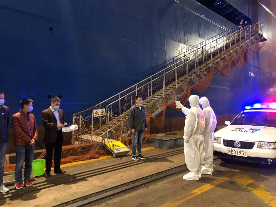 Sailors in quarantine at change of shift