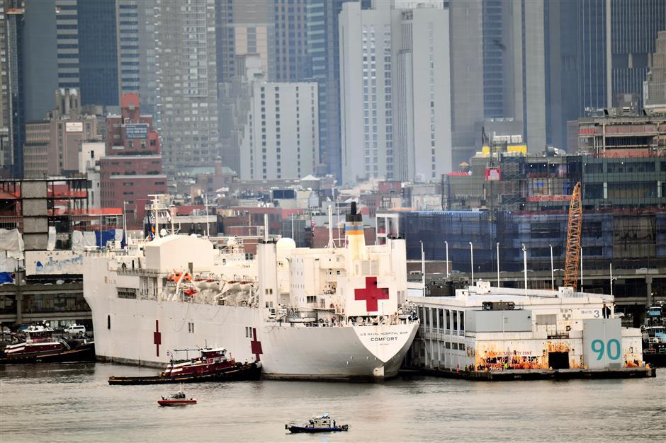 New York gets hospital ship as coronavirus accelerates in US