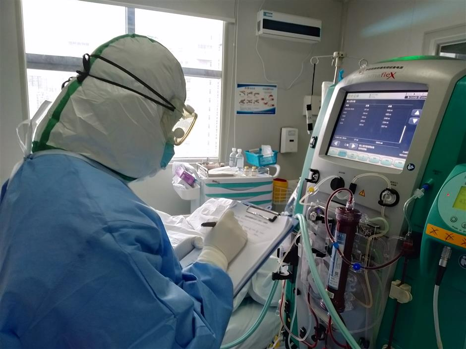 Zhejiang medics back home after heroic efforts in Hubei