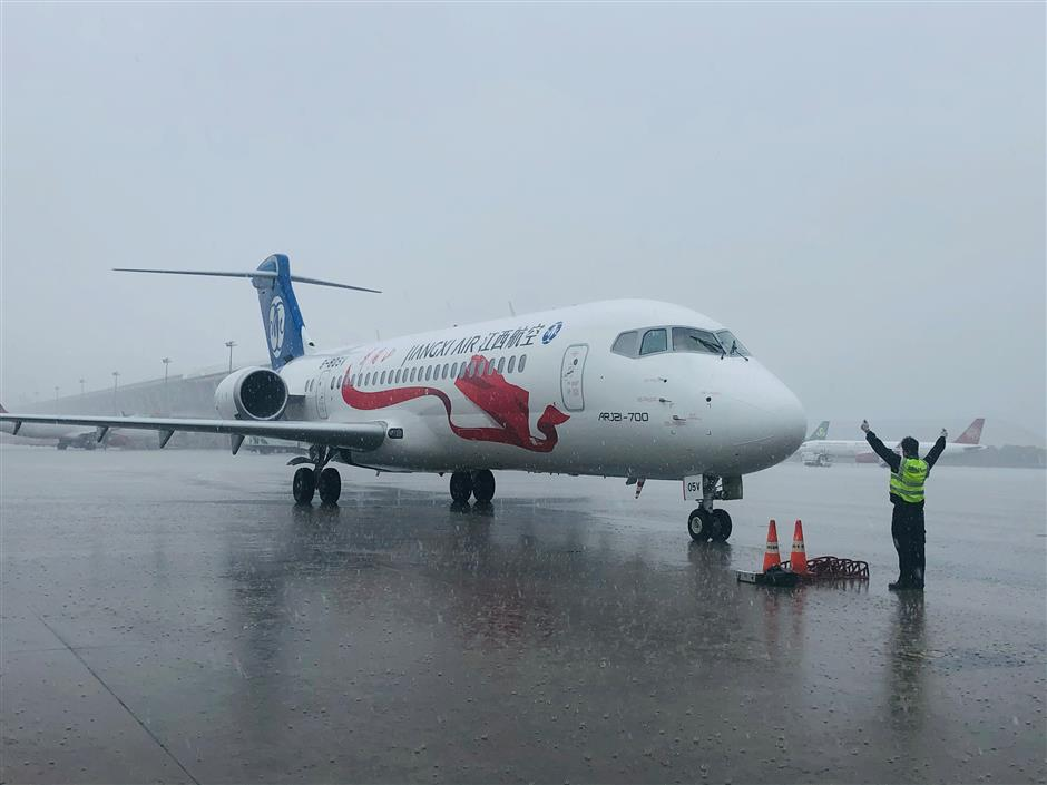 Shanghai first as domestically developed jet lands at Pudong