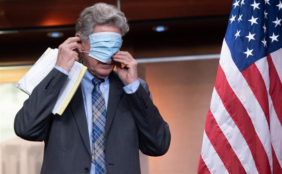 Fauci warns as US virus death toll hits 100,000