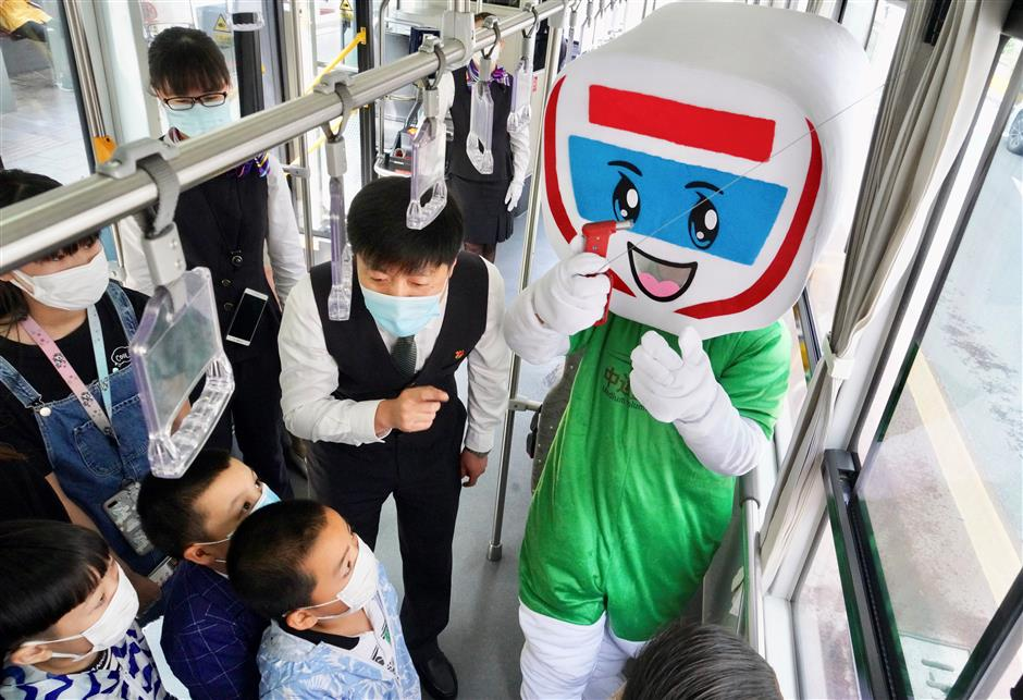Colorful mascot teaches children about bus safety