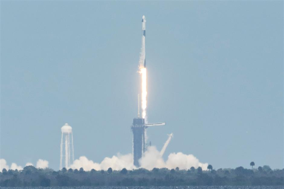 SpaceX successfully launches two NASA astronauts into orbit for historic flight