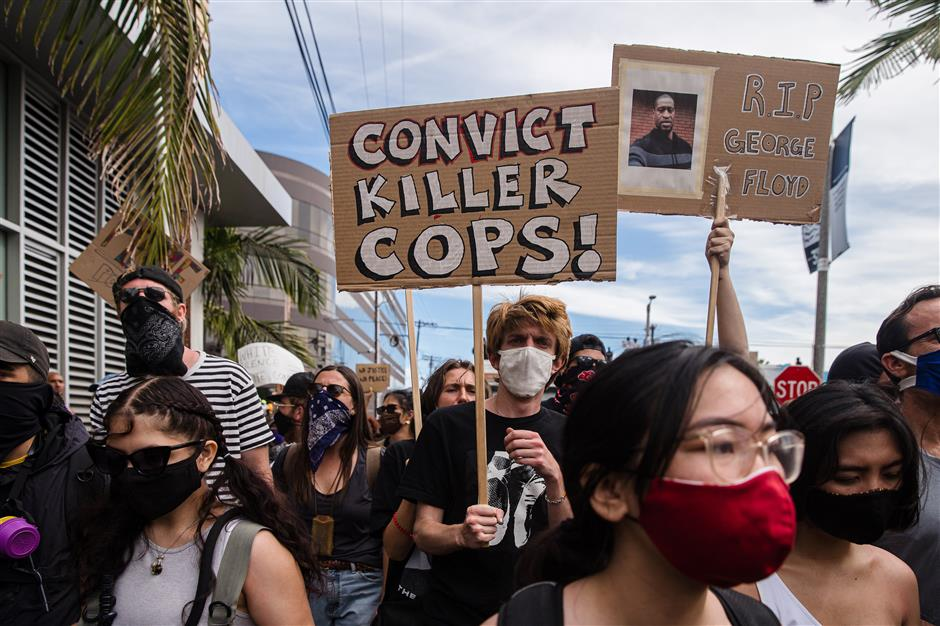 NY police clash with protesters marching against George Floyd death