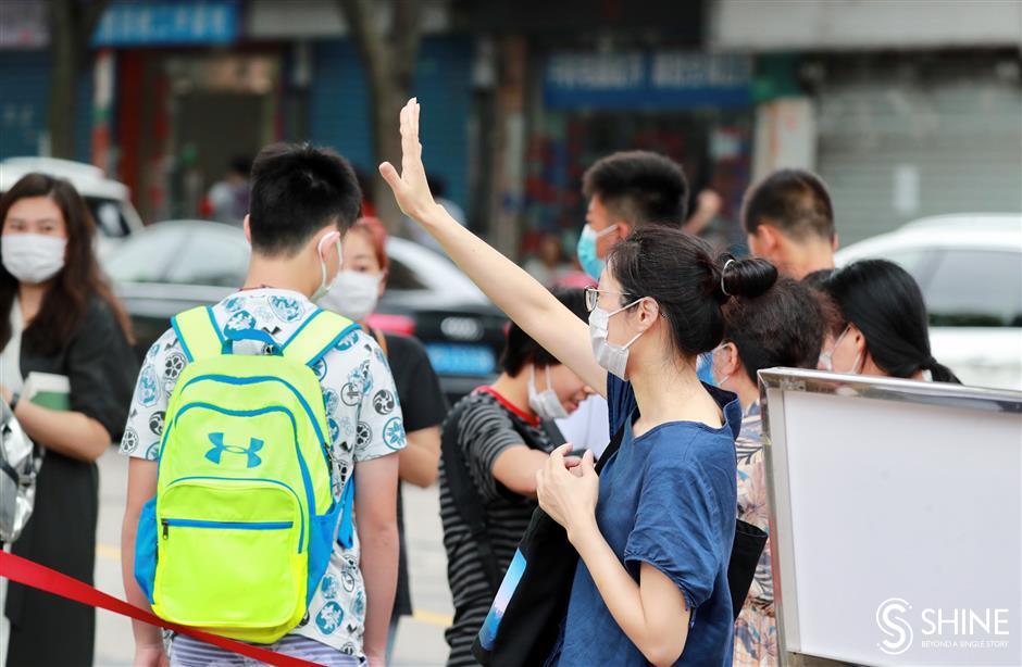Cheers and good wishes as students take middle school exams