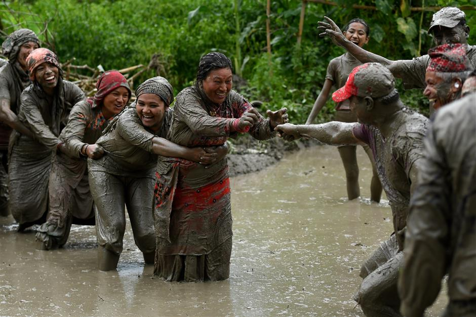 Playing and planting, Nepal celebrates paddy day