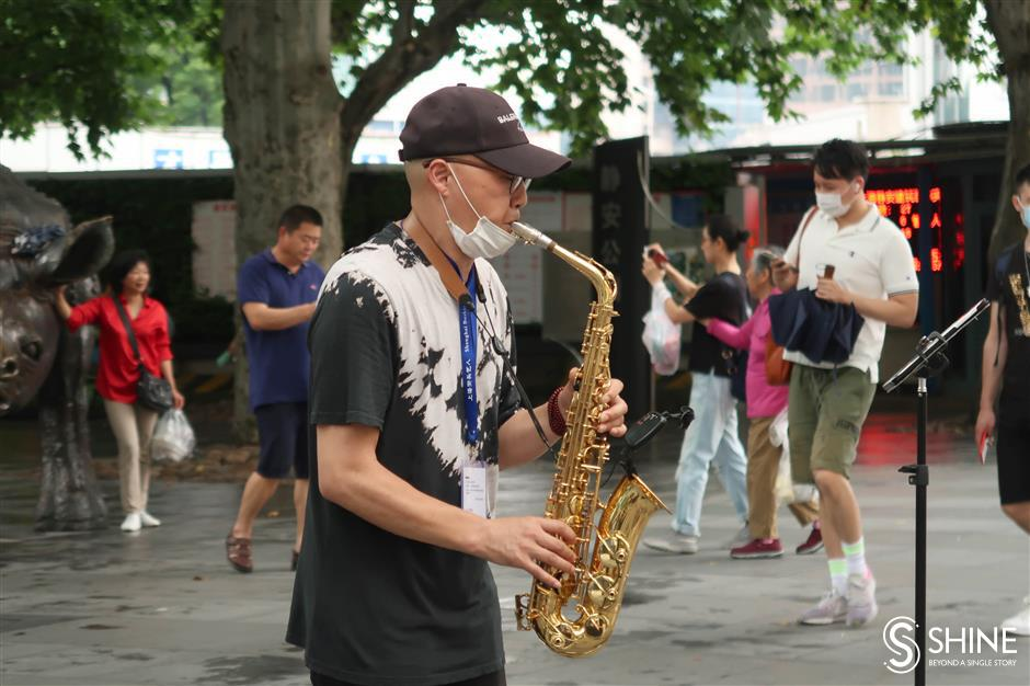 Licensed performers enliven city's streets
