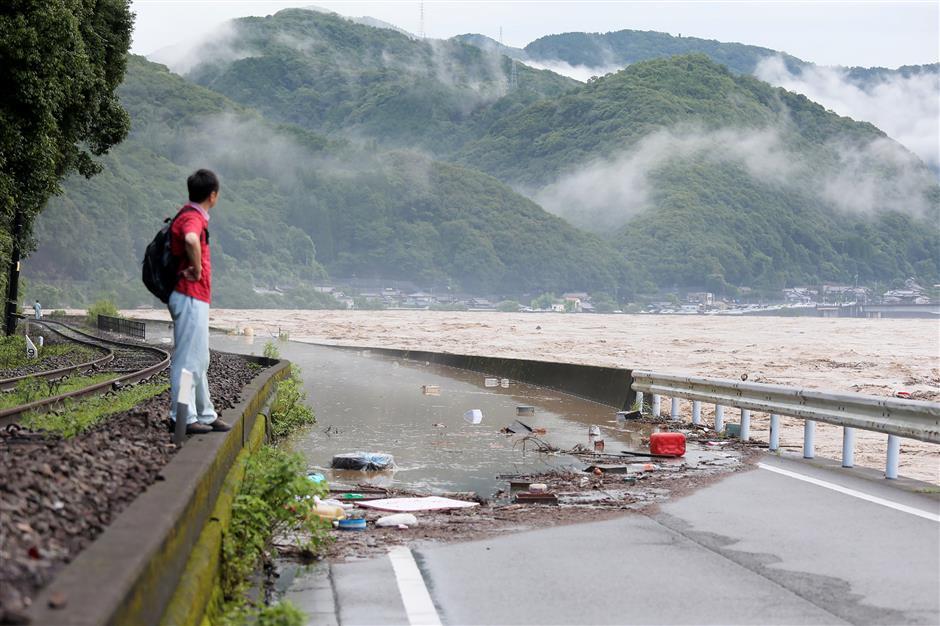 2 feared dead, 13 missing as heavy rain lashes western Japan