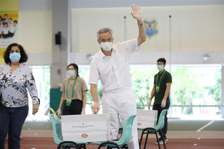 Singapore's ruling party retains power, but with record low vote