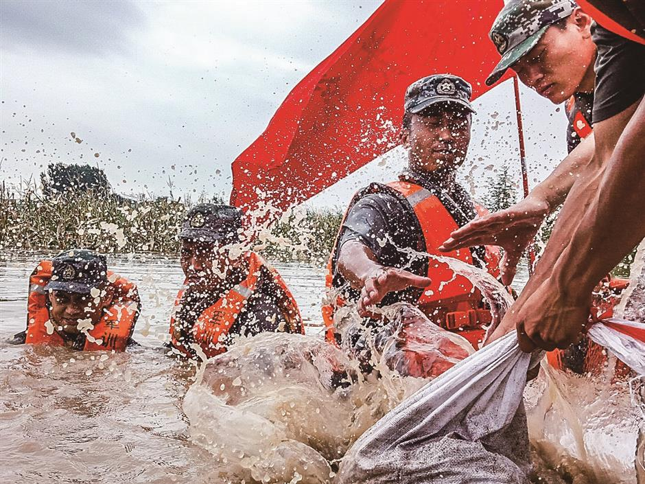 Locals fight deluge after downpour hits China