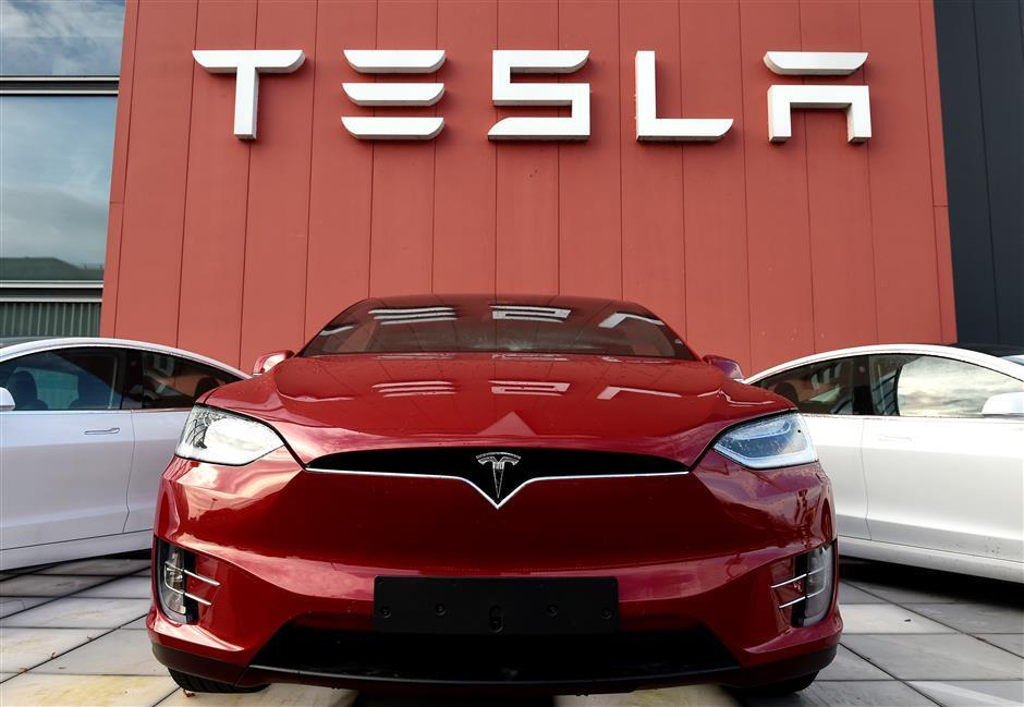 Highflying Tesla reports surprise profit despite COVID-19 upheaval