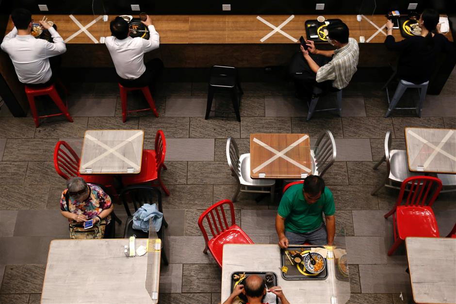 HK bans restaurant dining in virus fight