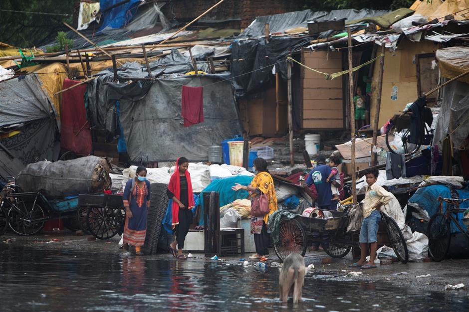 Coronavirus cases surge in India as half of slums' population test positive