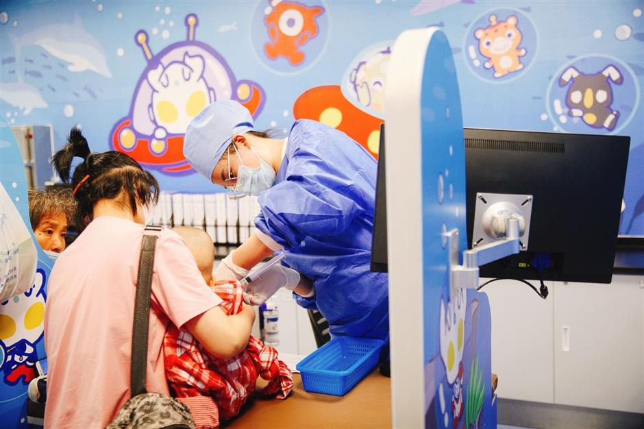 Xinhua Hospital opens new pediatric care building