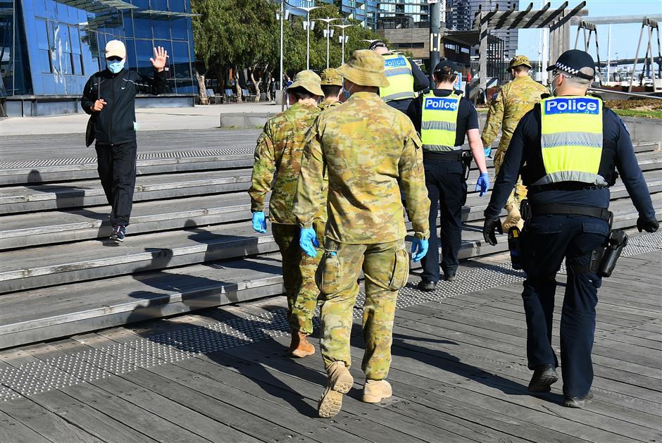 Melbourne put under curfew as virus runs wild