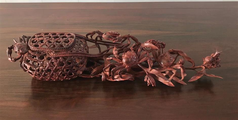 Intricate carving art has a future, knock on wood