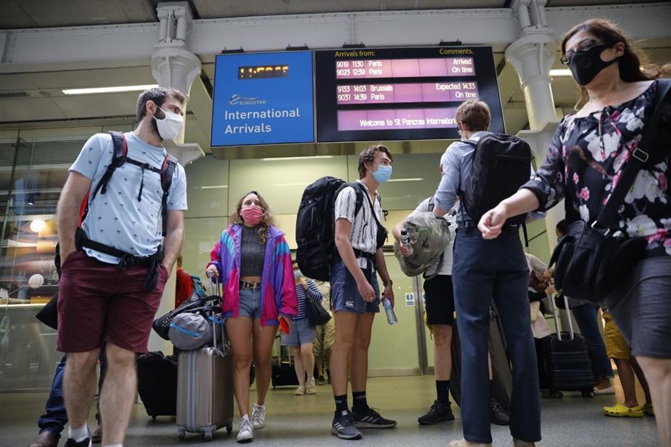 Returning Brits begin quarantine while Russia rolls out vaccine