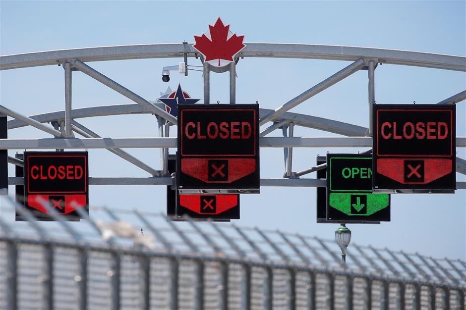 US, Canada extend travel ban to curb COVID-19
