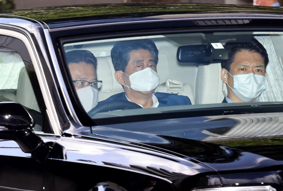 Japan PM returns to hospital as he breaks term record