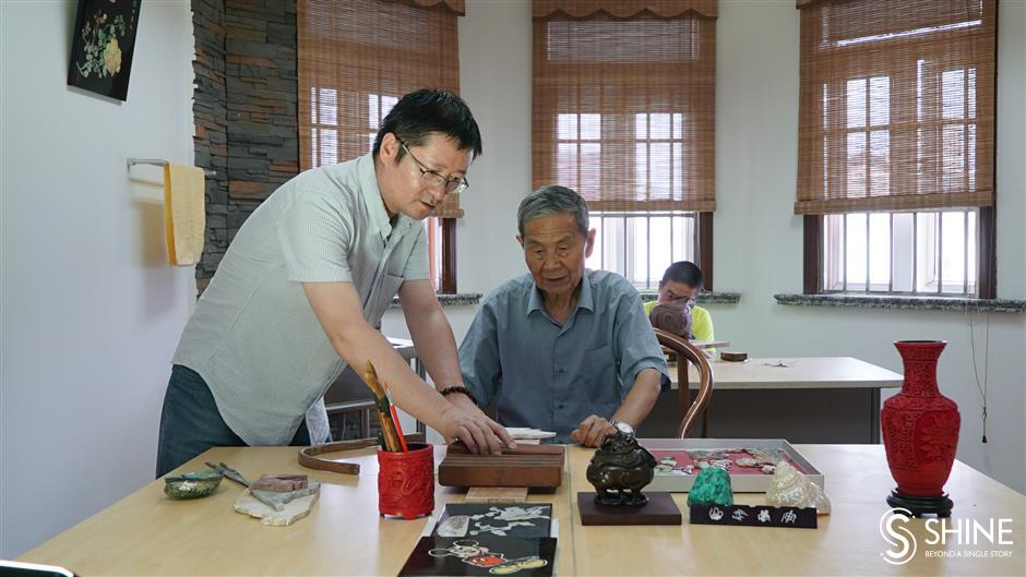 In a local workshop of heritage artworks, like father, like son