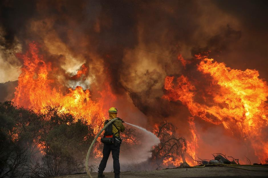 Fire on all sides as out-of-control blazes wreak havoc in California