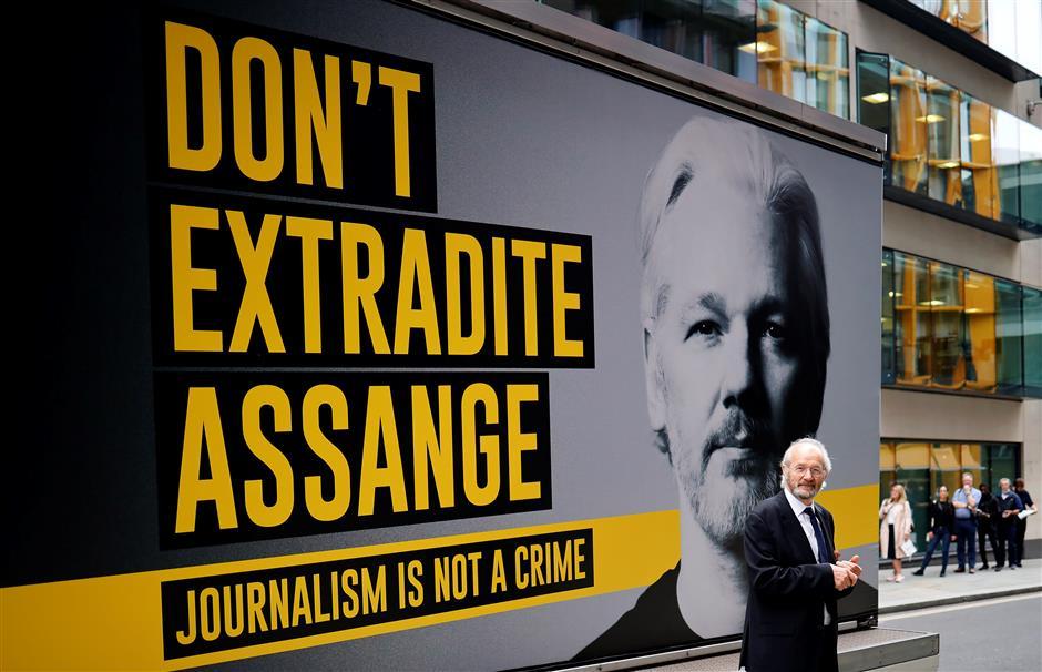 Virus scare halts Assange extradition hearing