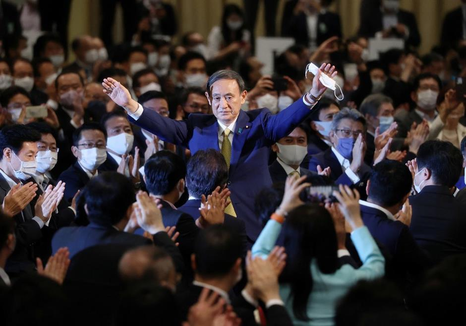 Japans Suga fills key LDP executive posts with veteran lawmakers, Cabinet takes shape