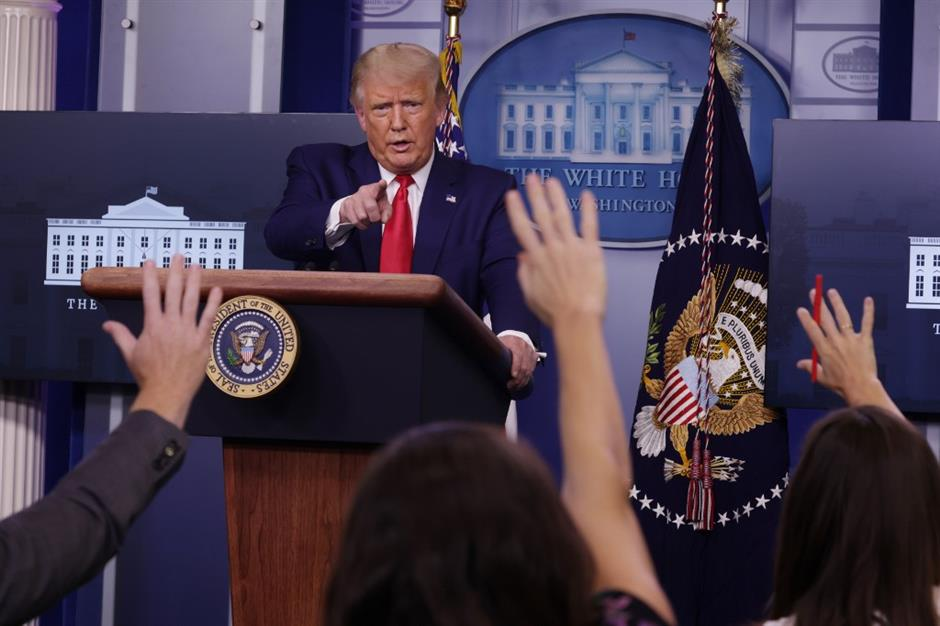 Trump doubles down on vaccine timeline, contradicts top expert