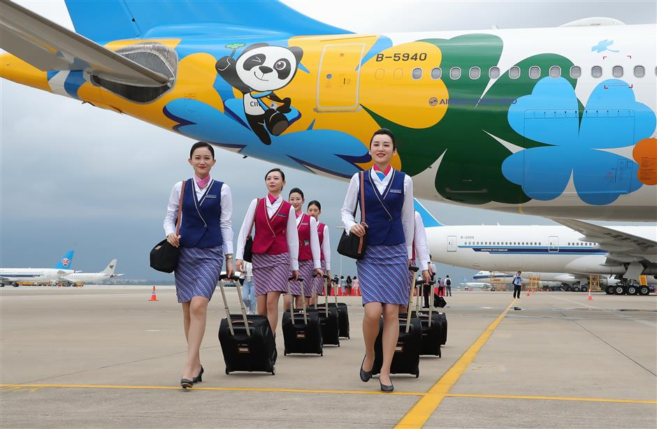 Touchdown as aircraft with CIIE livery lands