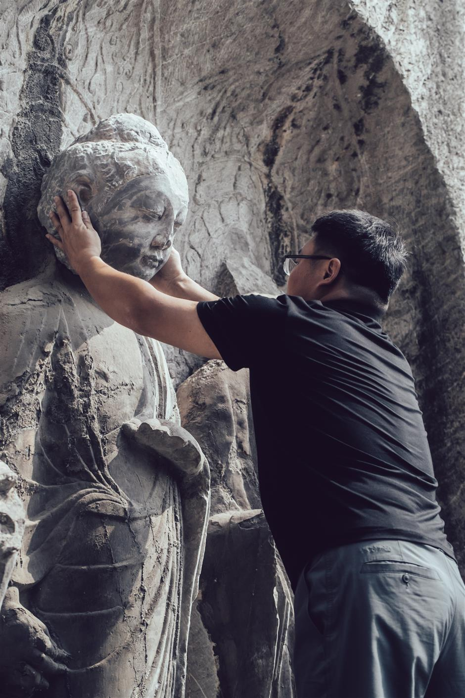 Buddhas head restored on statue with 3D tech