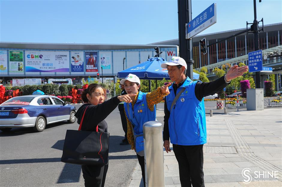 Volunteers, young and old, lend their time and talent to import expo