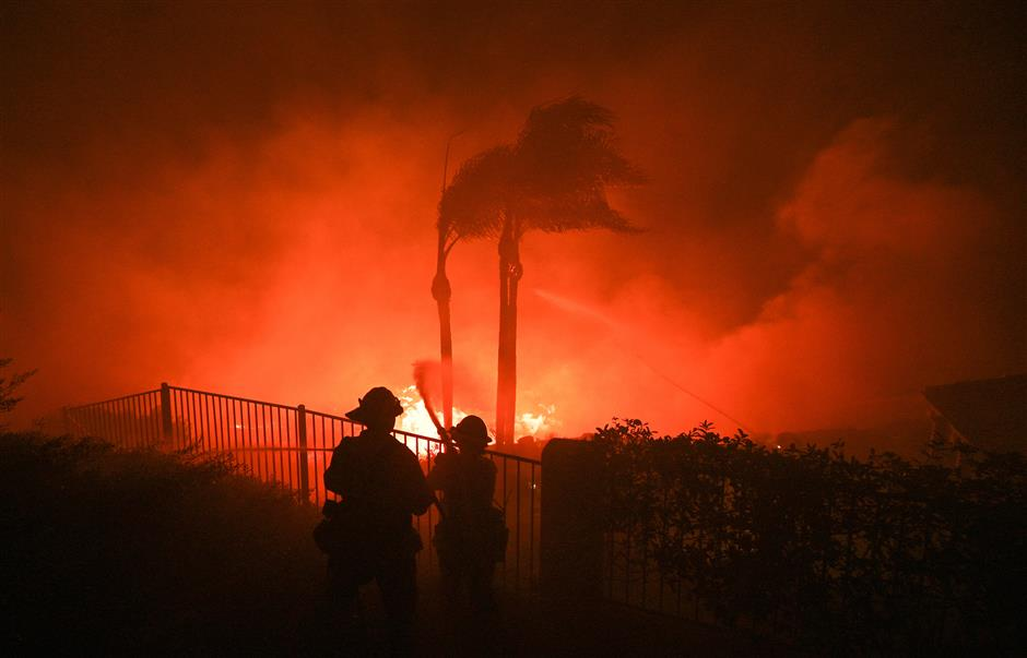 California wildfires drive 90,000 from their homes