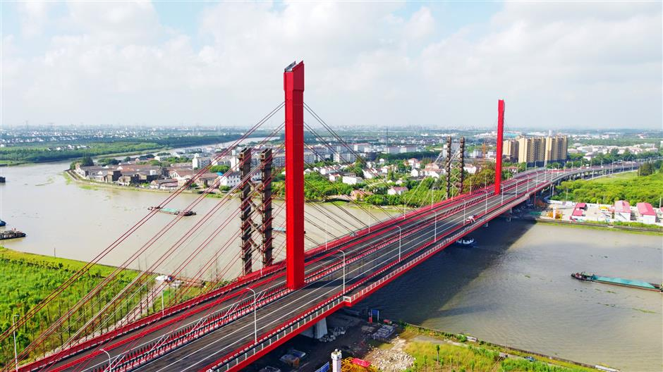 Bridges across the Huangpu River record stories of human endeavor