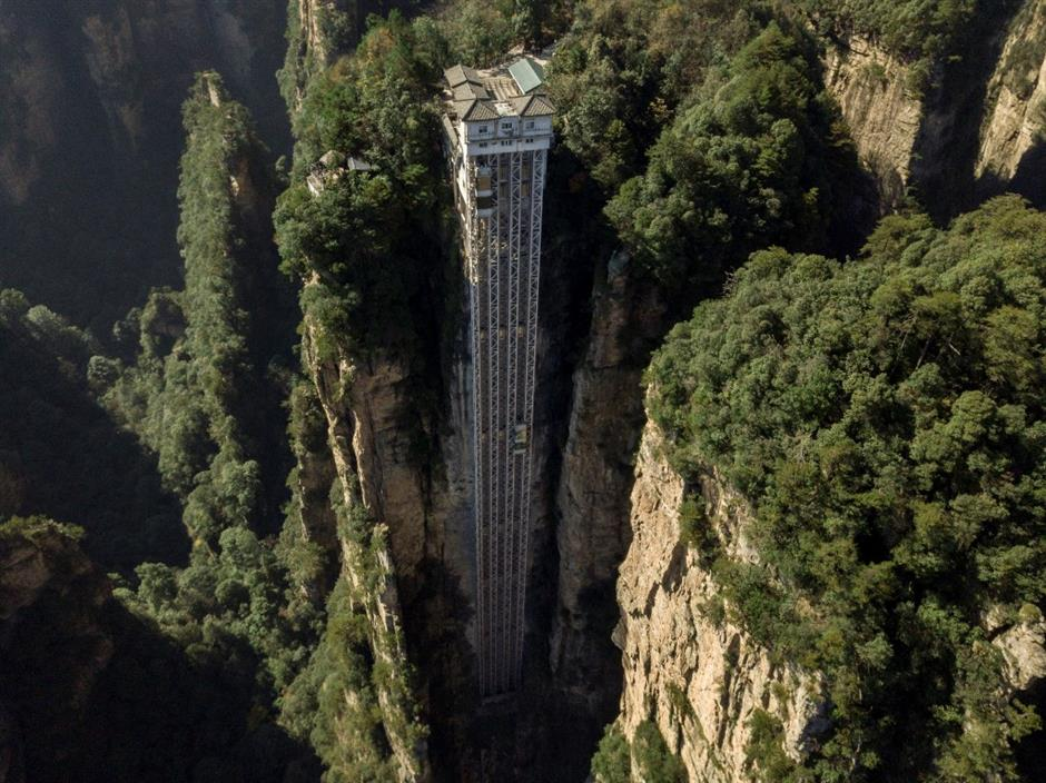 Towering outdoor lift zips tourists up Chinas Avatar cliff