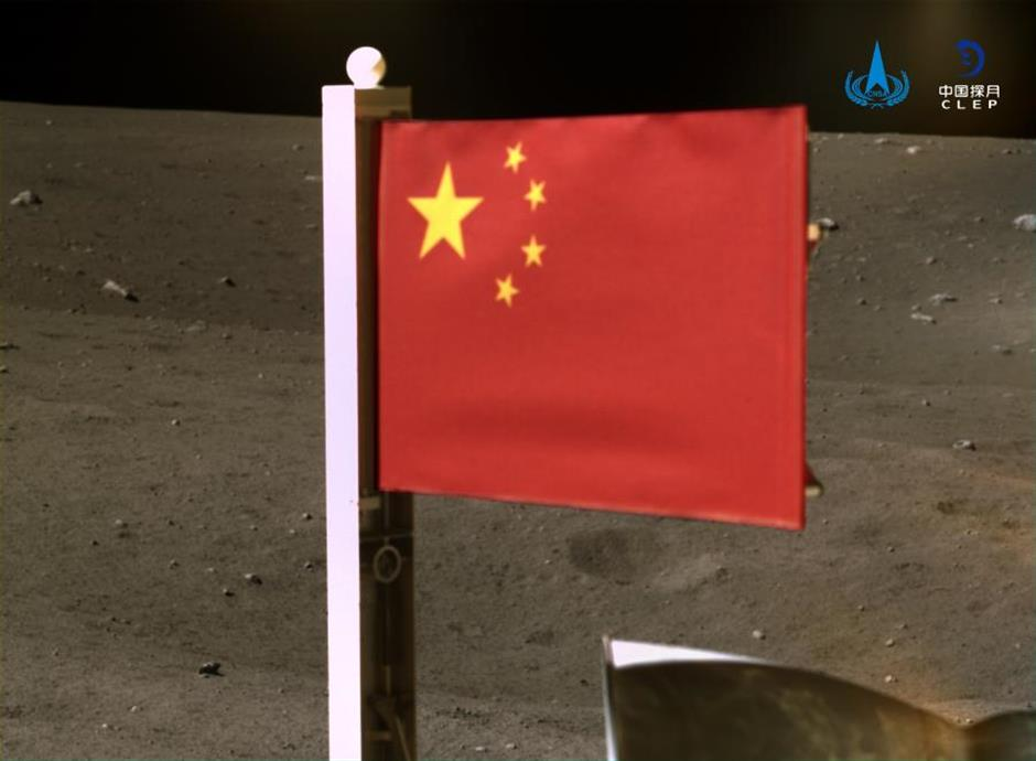 Chinas space agency releases images of national flag unfurled on moon