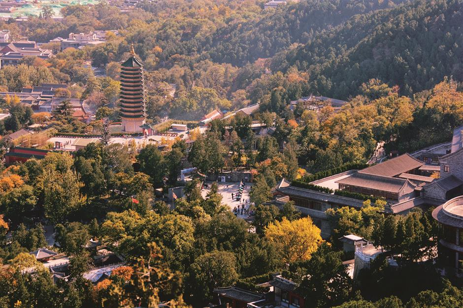 High up a mountain lies temple of beauty in honor of Guanyin