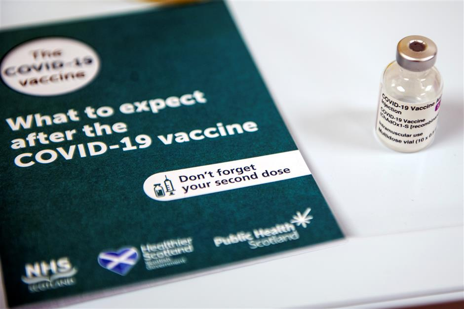 First Oxford vaccine administered amid United Kingdom lockdown calls