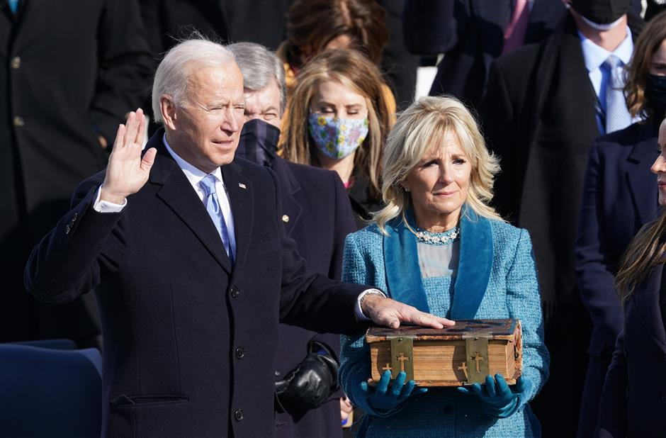 Biden sworn in, takes helm of a deeply divided nation