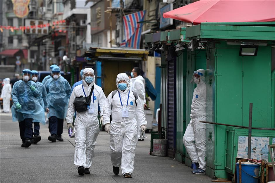 HK reopens district after thousands tested for virus