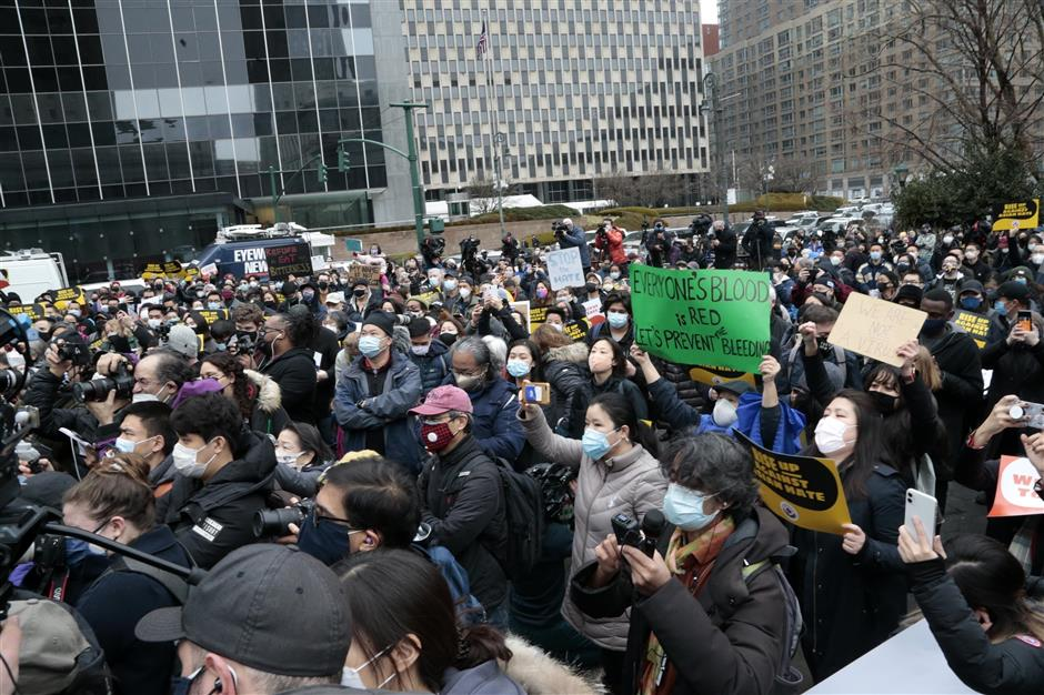 Protesters call for an end to attacks on Asian Americans