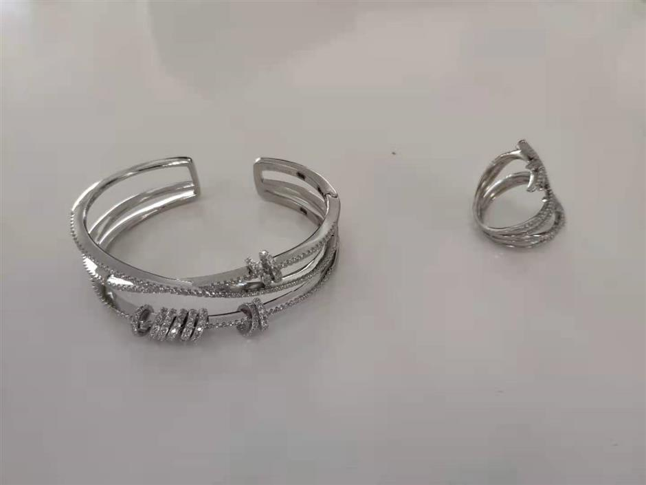 Suspects held after fake accessories seized