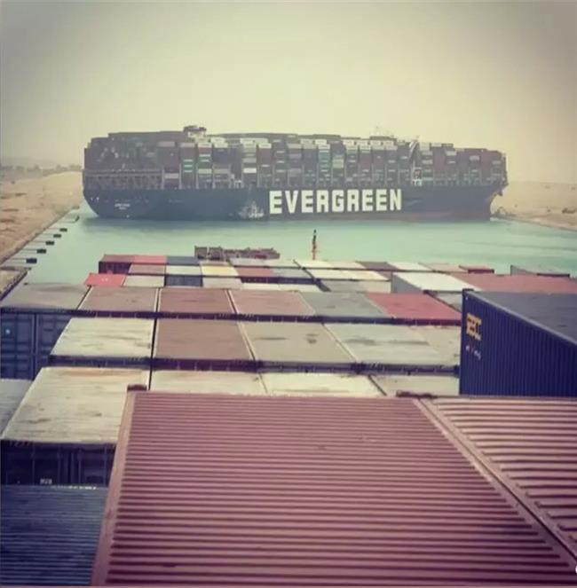 Ship blocks Suez Canal after gust of wind knocks it off course