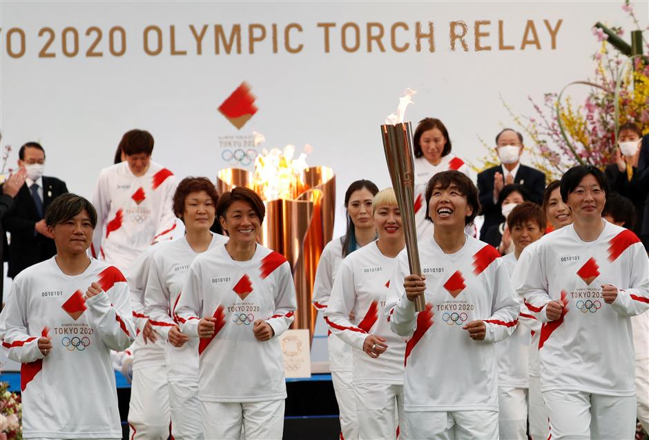One year late, virus-delayed Tokyo Olympic torch relay begins