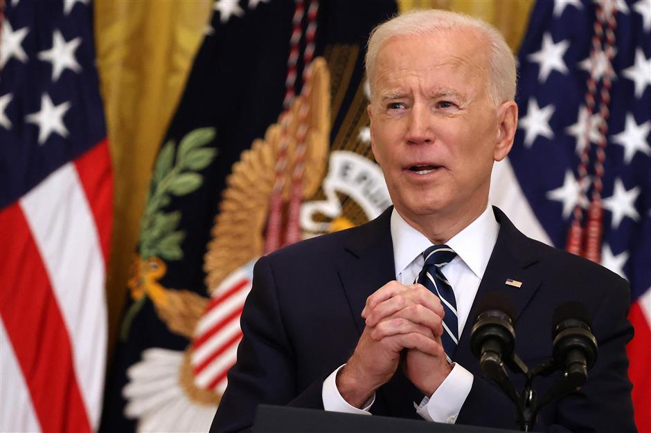 Biden doubles vaccine pledge, says plans to run again