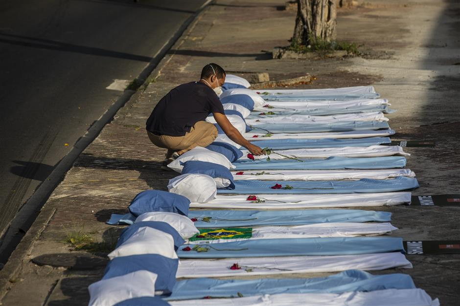 Brazil targets 1m shots a day as death toll passes 300,000