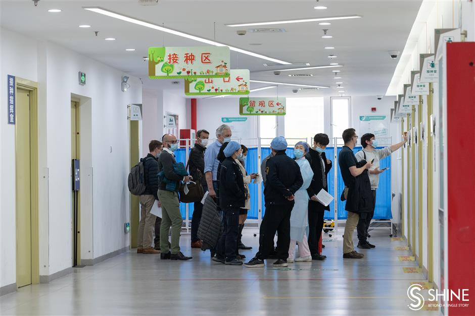 Local expats vaccinated against COVID-19