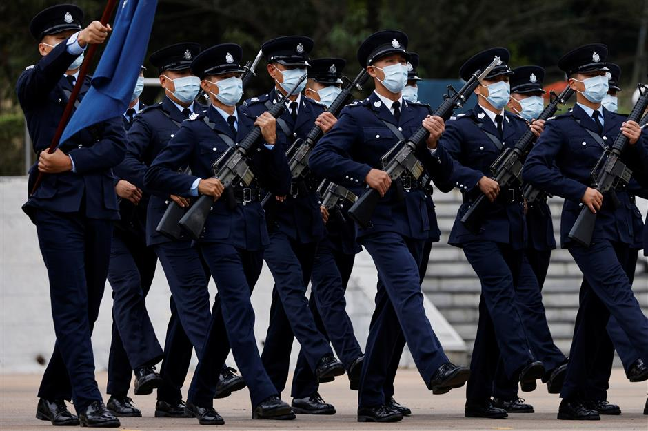 Top Beijing official in HK warns of teaching foreign forces a lesson