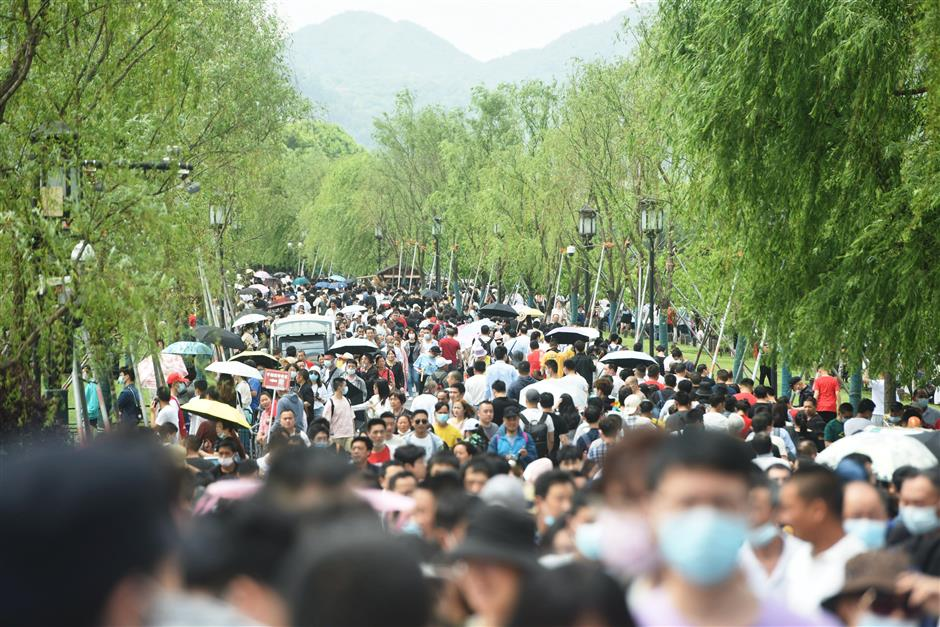 China Labor Day travel rush gives glimpse of life after coronavirus