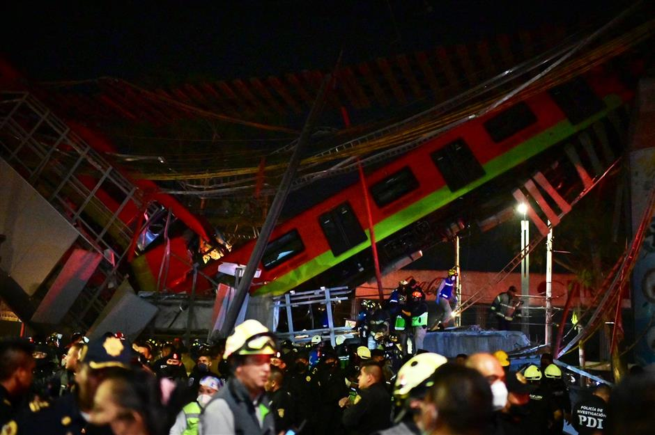 Mexico City rail overpass collapses, killing 15